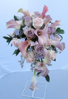 Cascade bouquet of calla lilies and roses with butterflies and crystals