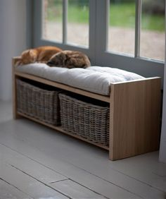 Versatile Oxford Raw Oak Storage Bench with 2 large rattan baskets, ideal for a hallway, utility or foyer. Feather filled and fibre seat pad...