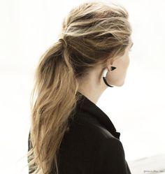 Givenchy shark earring, messy ponytail, black blazer / Garance Doré