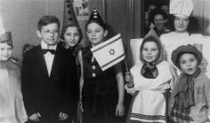 Purim celebration for Jewish children at an orphanage in Lodz run by the Koordynacja (Coordination Committee). 1949.