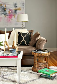 fall home tour living room whicker side table sheep fur throw brown sofa decorating