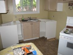 Reassembling the kitchen with a mix of old and new cabinets from Kijiji