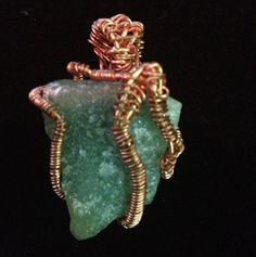 Green Calcite wire wrap pendant on etsy.com by The Crystal Pyramid $13.99