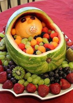 "Watermelon baby ... I clicked to this site and it appears to only be the photo of this but it looks self explanatory.Simply assorted fruits with a melon head LOL!  What a GREAT, healthy, fun, idea!!! I will be doing this for a party. Would be SUPER for a baby shower dontcha think?! Found this pic at ""creative works"""