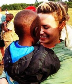 Demi in Kenya. This has to be the sweetest picture ever! Demi, you are my idol
