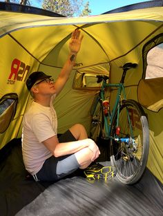 Yes, you can there is a tent where you can sleep with your bicycle so it is secure.