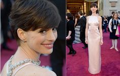 Oscar's Academy Awards - Anne Hathaway wore Lucida's necklace, earrings and bracelet by Tiffany & Co. Prada Dress