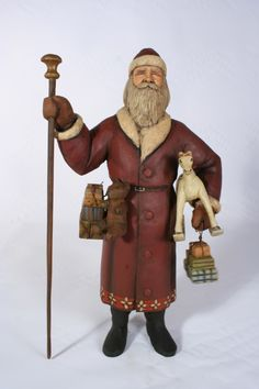"""Red Santa with Rocking Horse  wood carved Santa with presents and rocking horse. 15"""" tall By  Ed Pribyl    $895."""