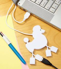 We have introduced all kinds of fun USB hubs for your USB gadgets. But if you prefer those cute dogs, the poodle shaped USB hub may draw your more attention. Hub Usb, Gadgets And Gizmos, Tech Gadgets, Electronics Gadgets, Wine Gadgets, Office Gadgets, Usb Drive, Usb Flash Drive, Objet Wtf