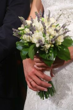 Lavender and white fresia bride bouquet by Gourioti Flowers