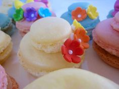 To create these Easter bonnet French macarons, I divided the macaron batter into three equal parts, then tinted each pastel colors of yellow, pink and blue.