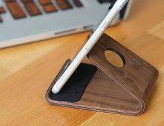 The beautiful shape of the Wood iPhone Stand has been achieved by bending plywood from Walnut lined with Alcantara.