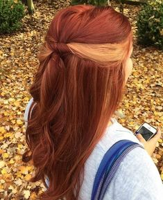 copper red hair with blonde peek-a-boo highlights