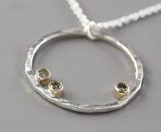 Large Sterling Silver and 14k Hammered Hoop Necklace with Diamond--Made to Order. $530.00, via Etsy.