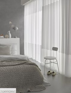 Een mooie zachte inbetween zorgt voor een romantische sfeer in de slaapkamer.