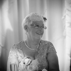 The Mother of the Bride enjoys The Groom's  speech on a wedding day at The Hangar, Milsoms Kesgrave Hall near Ipswich Suffolk. www.headoverheelsphotography.co.uk