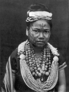 (Charles Kennedy-Craufurd-Stuart) The girls of the Chin Hills, in Upper Burma — southwest of the Triangle, where the slaves of the Kachins were declared free — commonly have their faces tattooed from early childhood. Doubtless one familiar with the hill-tribes could tell from the tattoo-marks that this young beauty is a Chinbok. The Chinbok tattoo represents a tiger.