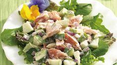 Smoked salmon, apples and cucumber form an unusual alliance enhanced with a creamy dressing.