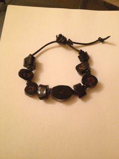 Genuine black coral an leather bracelet 23 grams. Adjustable for size. Make me an offer $$$