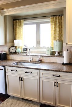 Curtains over kitchen sink.  Fun way to add color to the space. - like the extra shelf area behind sink