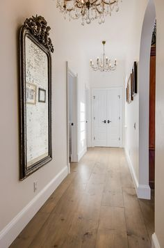 mirror, chandeliers, natural wood floor