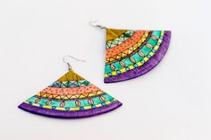 These earrings, uniquely made from multiple layers of paper are the perfect statement piece for any ensemble. Color should be worn  year round, dare to be different.