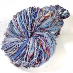 210 yards 4 oz skein of handspun art yarn. Worsted weight. Single spun not plied spun from Rolags. Woolen style.