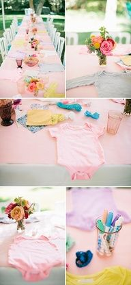 Onesie decorating table with multiple options for guests - cute idea for a baby shower