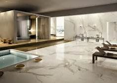ULTRA: This large format tile range encompasses a number of style options that range from solid colours to stone effect surfaces. Calacatta mimics the look of white marble and has realistic greay veins throughout each porcelain tile. Marble Interior, Home Interior, Marble Floor, Tile Floor, Marble Wall, Marble Tiles, Wall Tiles, Modern Floor Tiles, Casa Top