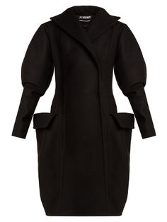 Tap Jacquemus's polished take on avant-garde styles with this black wool coat. Tailored to an exceptional standard, it's shaped with oversized lapels and long sleeves that are dramatically puffed on the upper arm, while the exaggerated flap detailing on the pockets draws attention towards the hips. Slip it on over equally striking separates for a commanding finish.