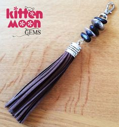 New in my Etsy store today, this lovely handbag accessory with a brown suede tassel charm.