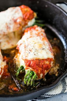 Asparagus Stuffed Chicken Parmesan is a easy, healthy dinner recipe that combines two of our favourites. Topped with marinara sauce and stuffed with cream cheese and asparagus, it's keto friendly, low carb, gluten free and ready in 30 minutes.