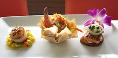 Seafood trio of scallop, shrimp, and salmon & #EdibleFlower Orchid