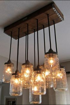 How To Make A Mason Jar Chandelier Primitive Home Decorating Every Dining Room Needs One Of These Diy Rustic Mason Jar Light Hanging Mason Jar Light Out Of Mason Jars Cafe Lights And A Wood… Mason Jar Pendants, Mason Jar Chandelier, Mason Jar Lighting, Lights, Jar Chandelier, Primitive Home Decorating, Pendant Chandelier, Mason Jar Lamp, Mason Jars