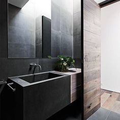 On the mood board tonight... this incredible bathroom by @robsonrakarchitects featuring mink grey American oak timber anchored by moody graphite grey rectified tiles. Filing this one away for our future bathroom! ❤️ #acupofchicloves #interiorenvy #bathroom #timber #americanoak
