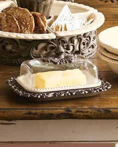 "Covered butter dish holds two sticks of butter or a block of cream cheese. Glass, ceramic and metal. 9""L x 7""W x 4.5""T. Imported."