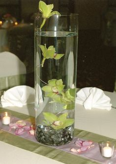Green Bride Redux: Simple (for real) DIY centerpieces. Floating dendrobrium orchids and water pearls. greenbrideredux.blogspot.com