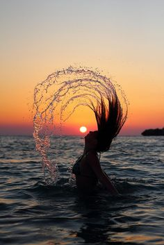 At sun dawn woman swings her hair