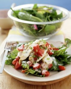 Bake chicken breasts with a seasoning of lemon zest and dried tarragon to make this chicken salad's flavorful foundation. Toss the chicken with chopped tomatoes and sliced scallions in a bright lemon dressing and serve on a bed of mesclun greens.