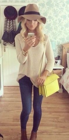 Wool fedora, slouchy dolman shirt, skinny jeans, lace up wedge booties