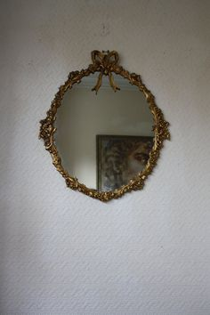 Pretty Oval Gilt Mirror with Ornate Frame and by ArthurandEde