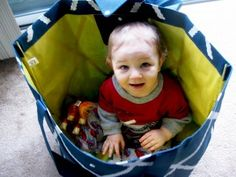 We carry our kids in lots of ways--usually not in bags though!