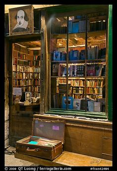 Shakespeare and Co storefront at night. Quartier Latin, Paris, France