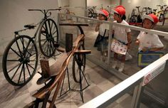 Japanese schoolchildren examine vintage bicycles at the Transportation Museum in Hiroshima.