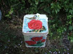 Old silver tea tin turned into something pretty and sweet.