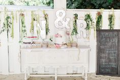 Simple cake & cake table at Natalie & Rick's wedding at The Sandbar on #AMI Photo Credit: Brooke Images
