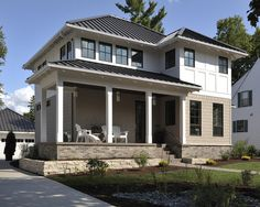 White Exterior With Black Metal Roof House Colors In