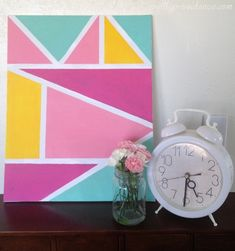 Super easy geometric wall art! Great way to fill up a large blank space on the cheap.