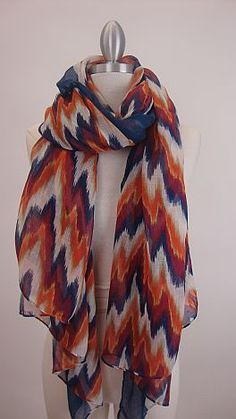 Navy and orange print scarf... perfect to pair back with denim. $26  #shopbluedoor