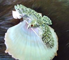 Marcasite and Garnet sterling bird in flight brooch